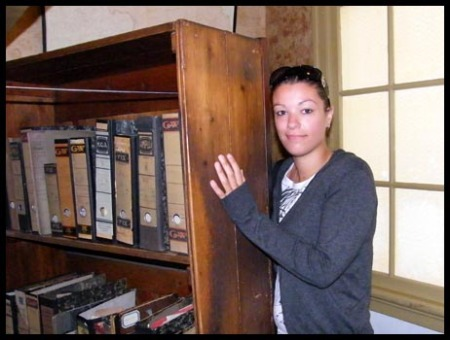 Me about to enter behind the wsecret book case which hid the entrance into the Frank's secret household