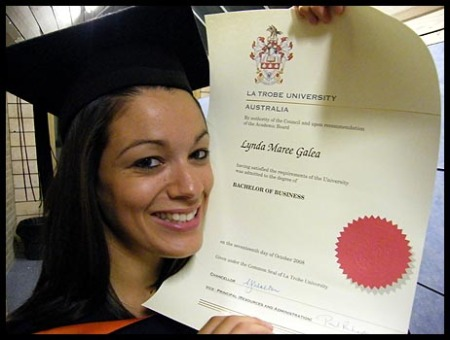 Me looking extremely happy with my degree after graduating