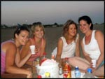 Me, Jess, Jade and Jac drinking on the beach in Barcelona, Spain