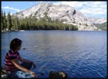 Me sitting and pondering by a lake at Yosemite National Park, California