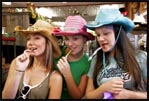 Monica, me and Crys trying on hats in one of the stores in Fort Worth, Texas