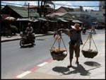 A Thai street seller walking in the heat, Phuket, Thailand
