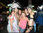 "Jess, me, Mel and Jac with the ""lady boys"" on Banlga Road, Phuket, Thailand"