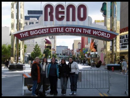 Sandy, Me, Kristi, Kim and Nic standing in front of the Reno sign